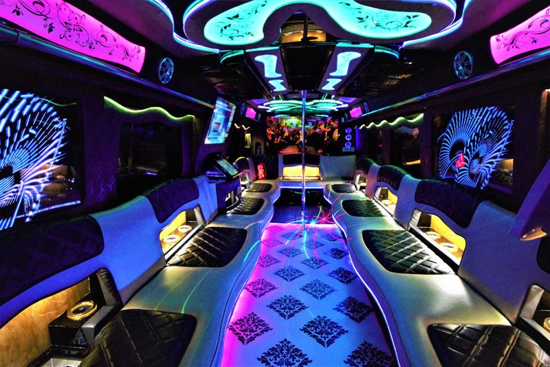 The interior of one of the Arabian Knights Limo Service party buses.